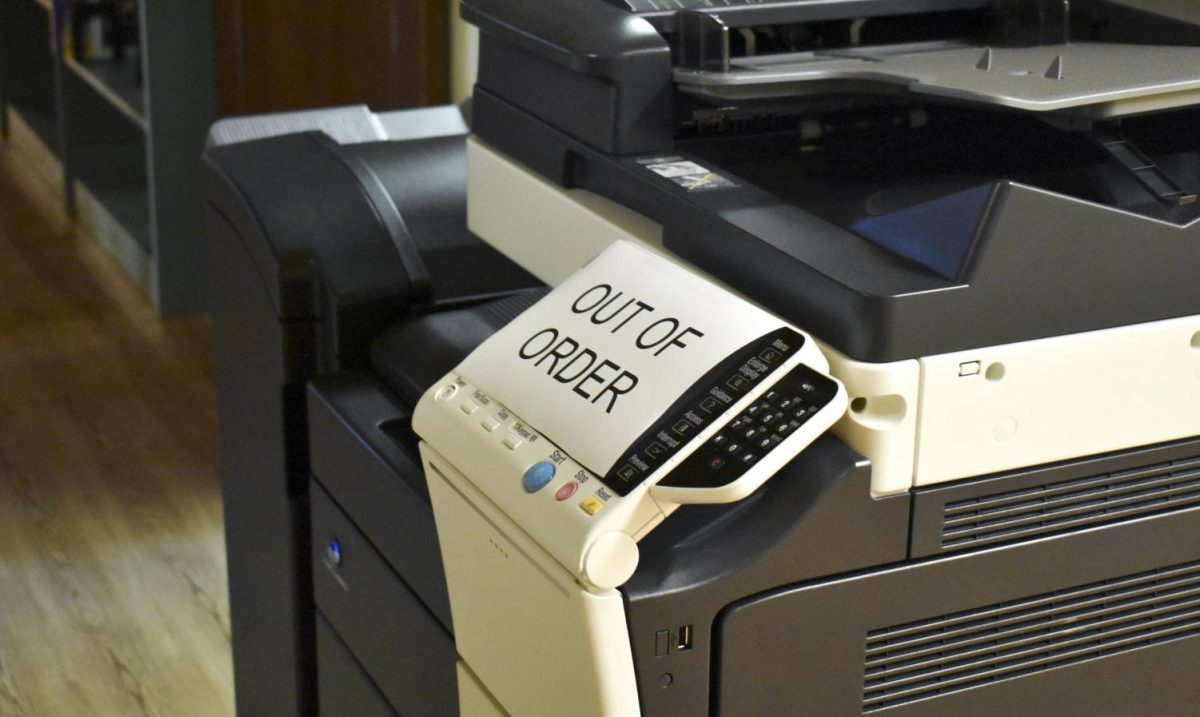 The+printer+sits+idle+until+a+solution+can+be+found+to+save+paper+and+ink.