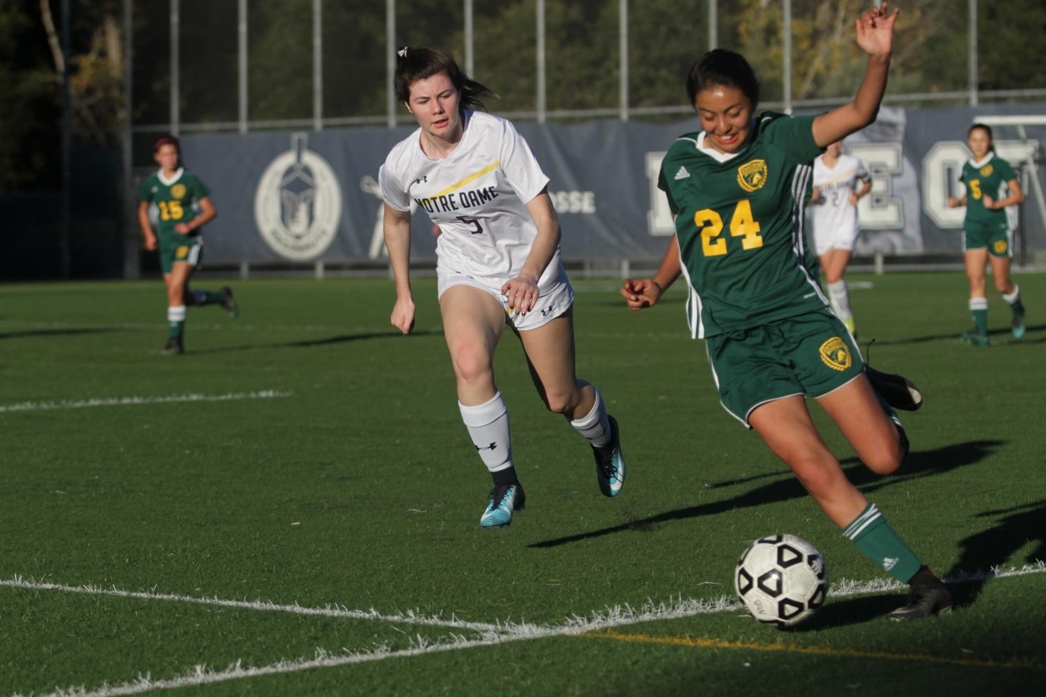 Defender Grace Earley ('19) puts pressure for control of the ball.