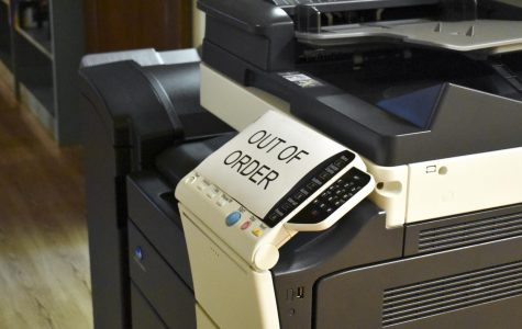 The printer sits idle until a solution can be found to save paper and ink.