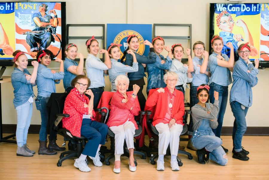 Students pose with real life Rosie the Riveters.