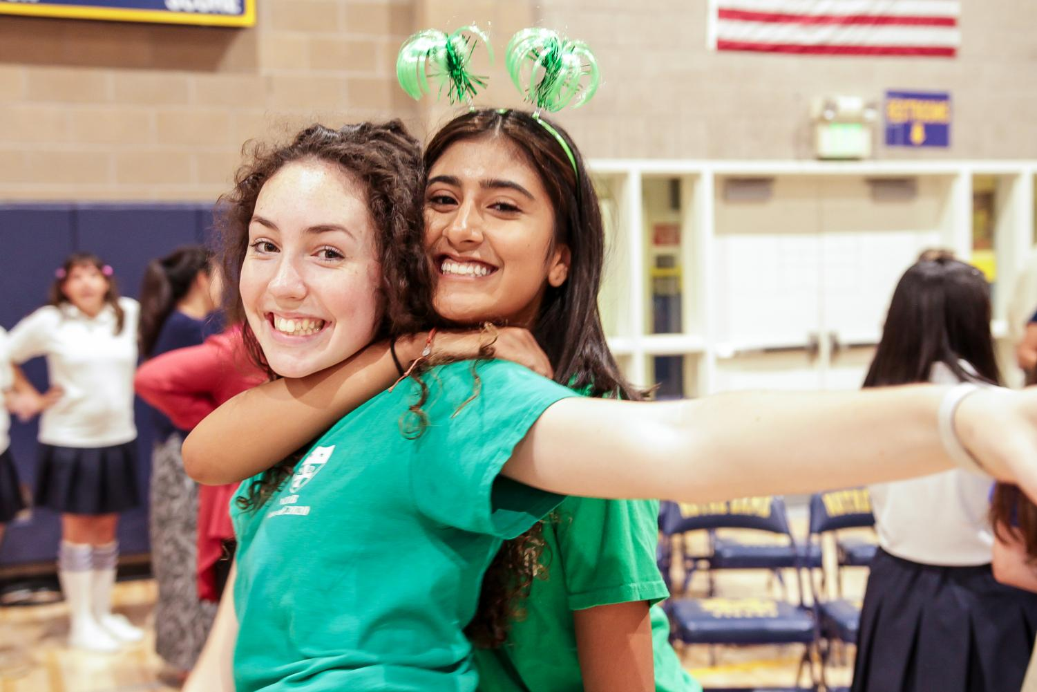Juniors Kate Rose Keighran and Bianca Lopez hug after the Welcome Back Rally.