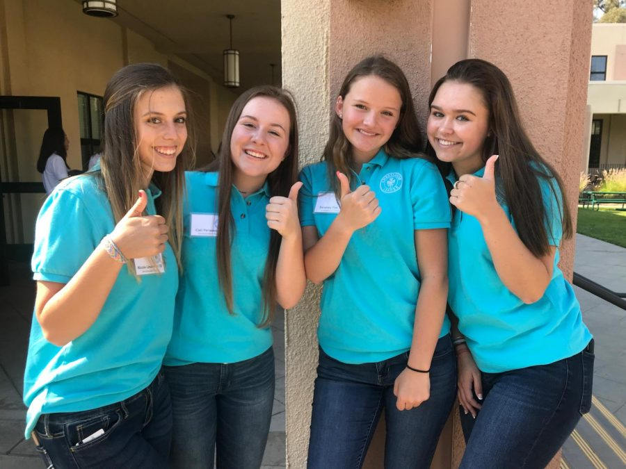 Ambassador club members greet freshmen, transfer  students and their families at the New Parent  Orientation.