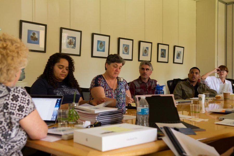 New teachers discuss the NDB Hallmarks during their orientation.