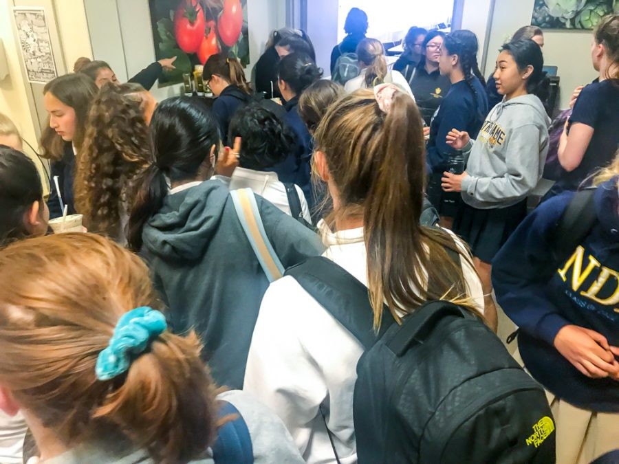 Students fill the servery during the afternoon break