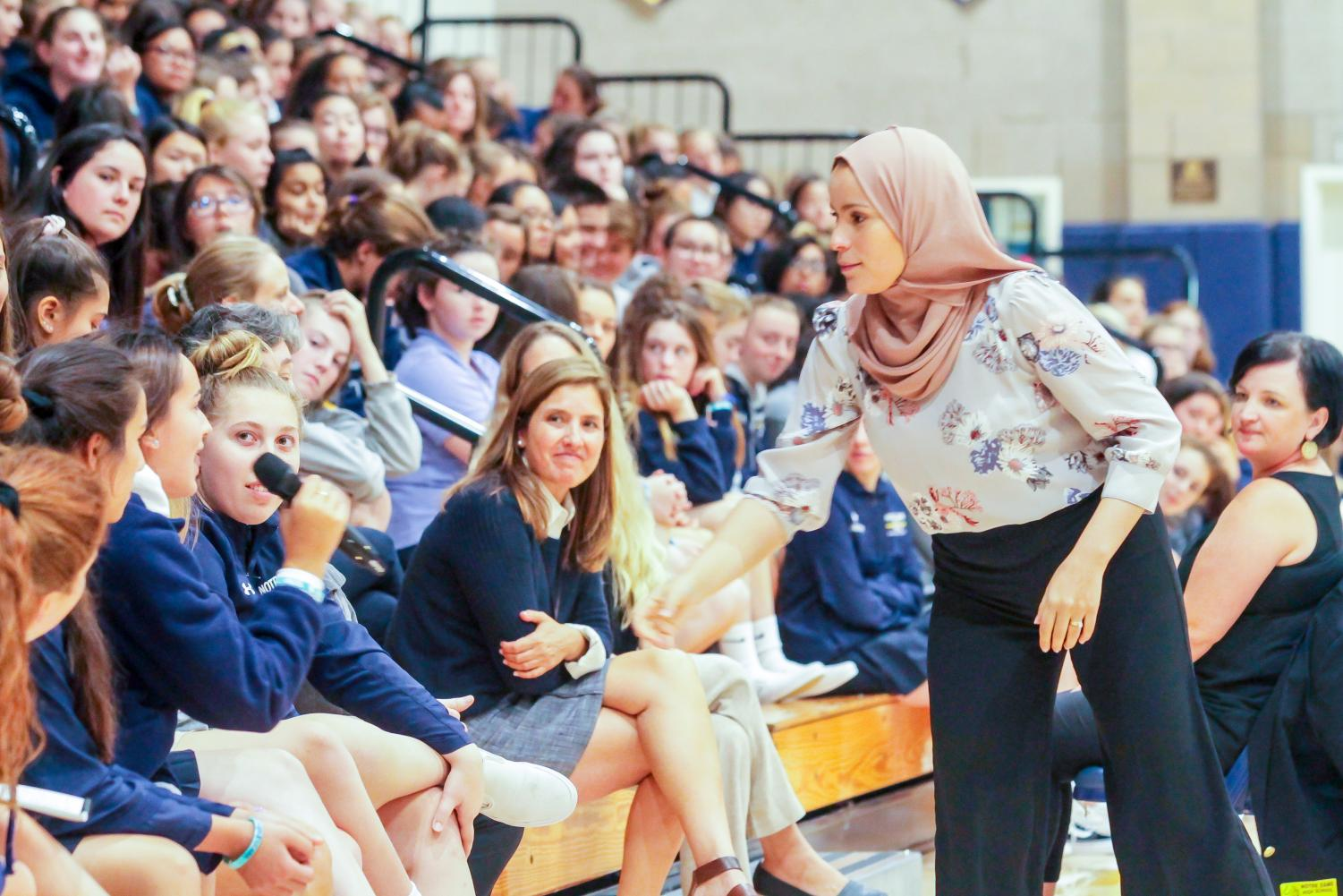 Dr. Alaa Murabit facilitates a discussion with students during a whole school assembly.