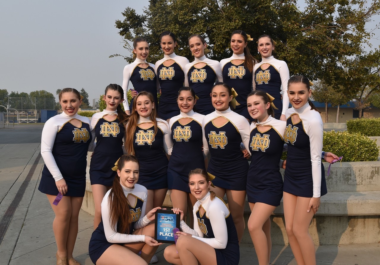 The pom team poses with their award.