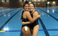 Seniors Callie Malone (left) and Alex Loos (right) during their waterpolo season in early September.