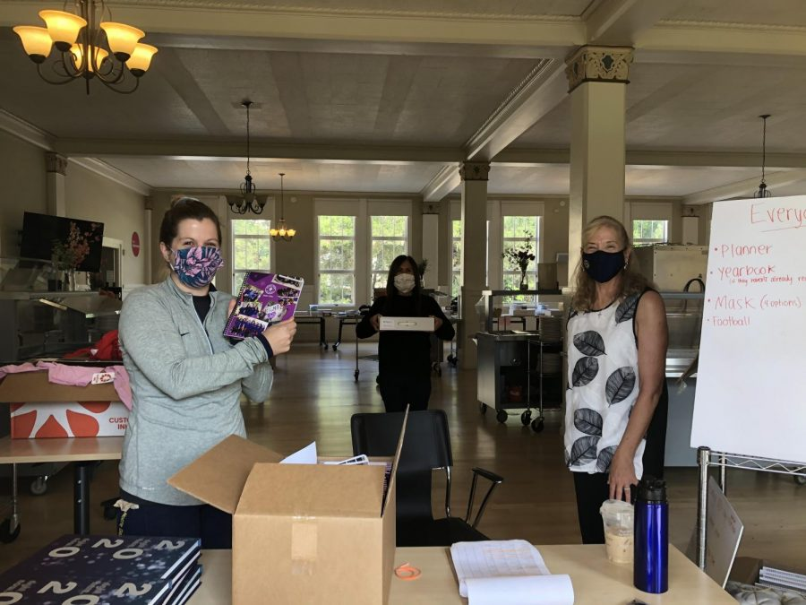 Deans Rachel Shanley and Alisia Bergholm and Associated Head of School Cathy Lewis coordinate the second day of school supply pick-up in the dining room.