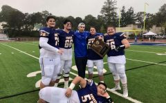 Dominic Barsi posing with some of his teammates after a successful game