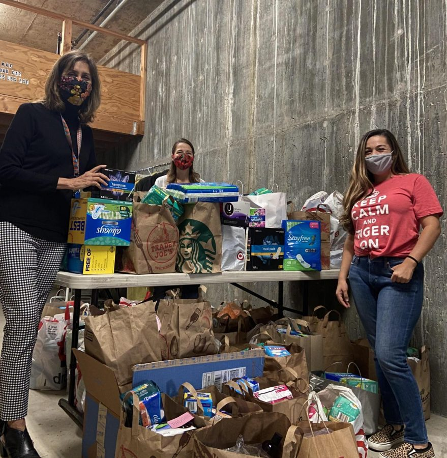 Alejandra Arias (right) dropping off collected items.