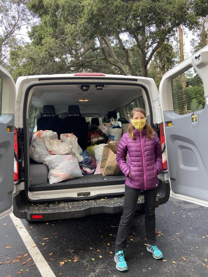 Ms. Jobin stands in front of the loaded van waiting to drop off donations from NDB's recent drive.