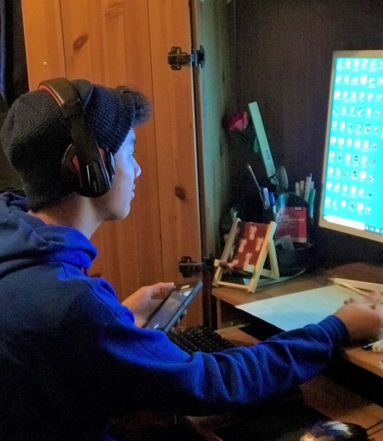 Local student Jason Huang spends time on his computer doing his homework just a couple of hours after he already spent time on his computer for school.