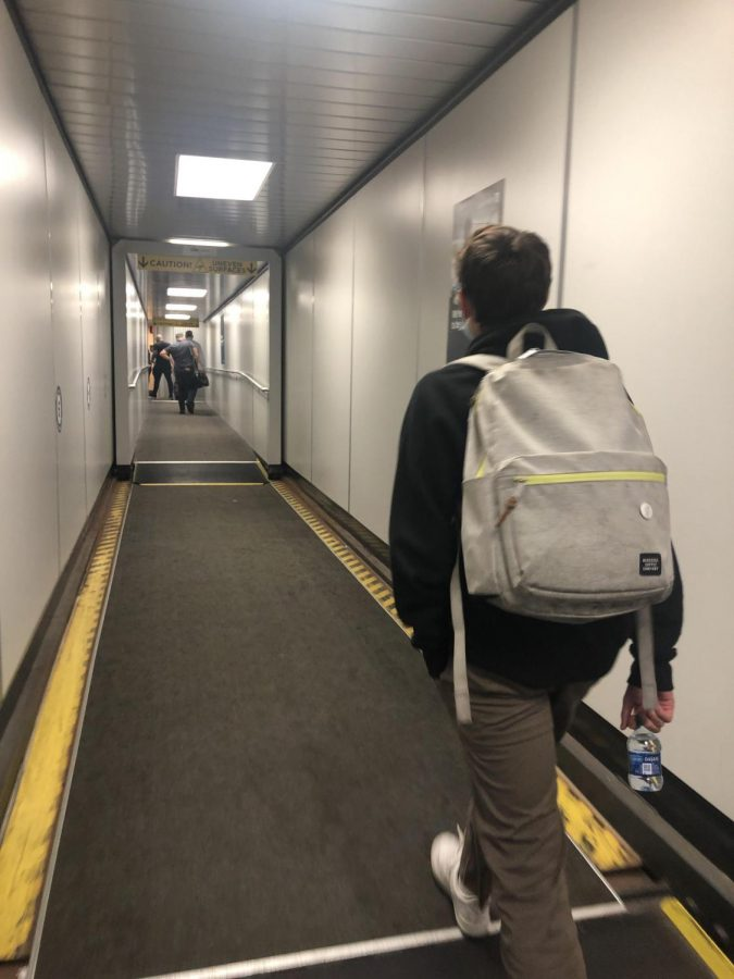 Serra sophomore Cameron Clarke prepares to board airplane under COVID-19 protocols.