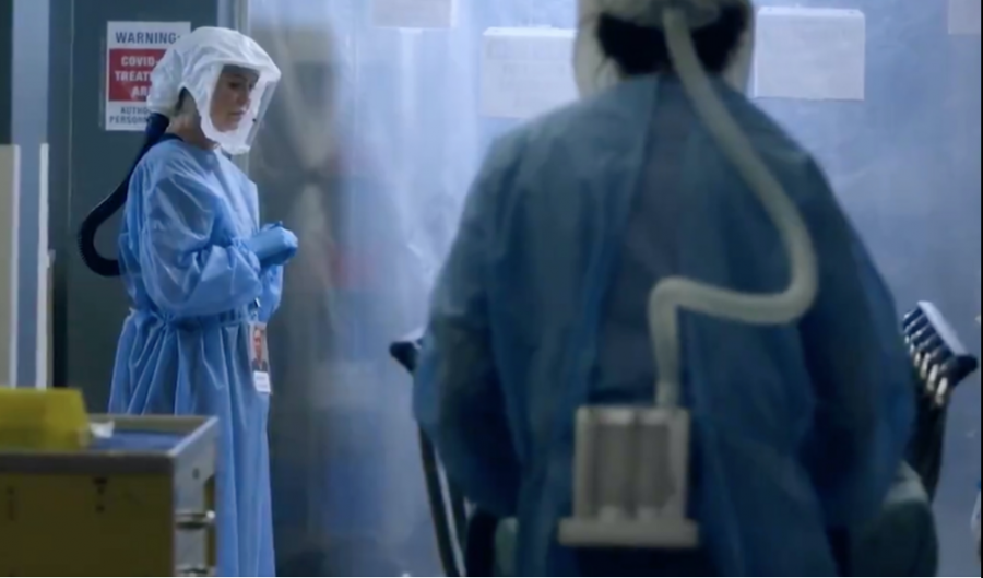 Meredith Grey, portrayed by Ellen Pompeo, pictured wearing hospital-grade protection in an episode of Grey's Anatomy.
