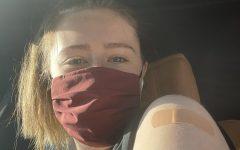 Ashlin O'Riordan shows off her vaccinated arm.