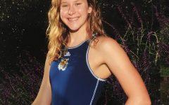 Rachel Schonfeld posing outside in her swim uniform.