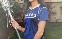 Gradidge in her lacrosse uniform and gear.