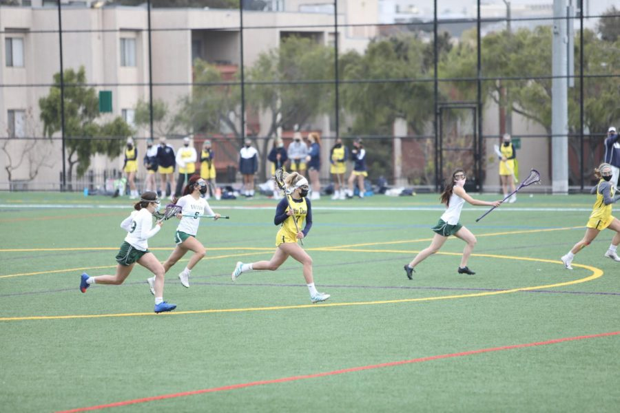 NDB+senior+Charlotte+King+runs+up+the+field+cradling+the+ball+during+a+game+against+Sacred+Heart+Cathedral+on+April+23rd+at+James+Lang+field+in+San+Francisco%2C+CA.%0A.