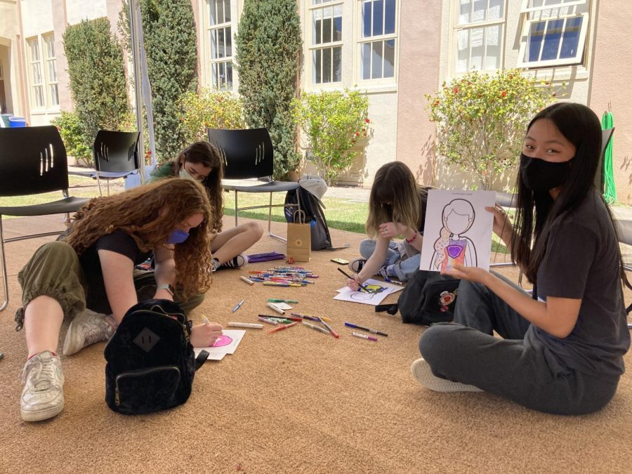 NDB sophomores Ciara Mangan, Ariana Kraemer, Kate O'Connor, and Hannah Nebres color their superheroes.