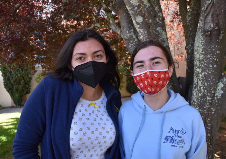 Masks cover people's smiles, limiting social interactions by making someone appear less approachable. Karla Aguilar and Emma Trainor smile through their masks.
