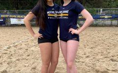 Senior Abby Miller (right) at beach volleyball practice last season.