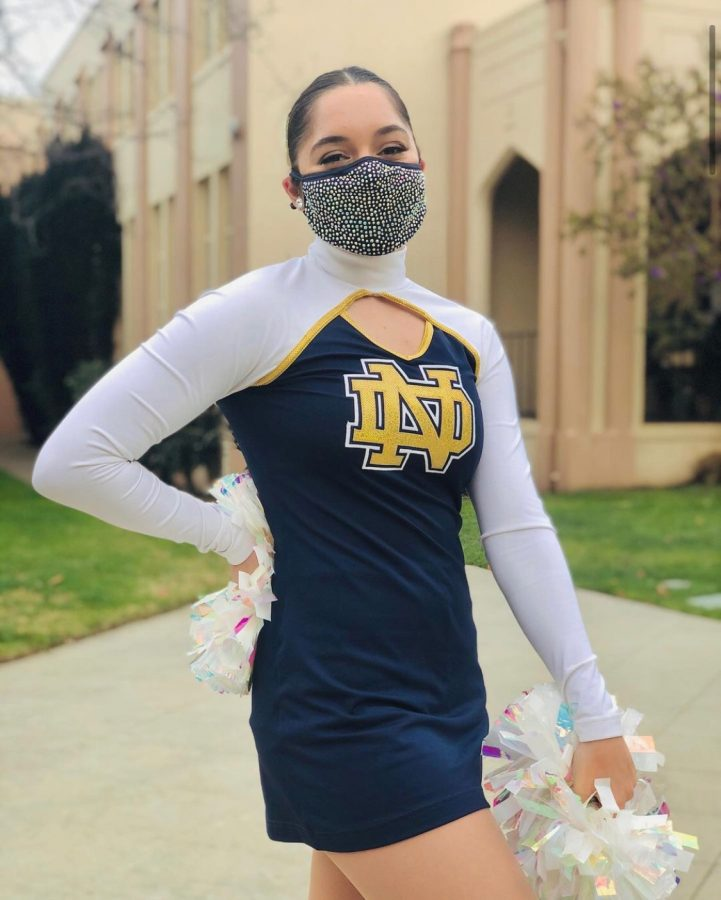 Senior Isabella Ailanjian in her pom uniform and gear.