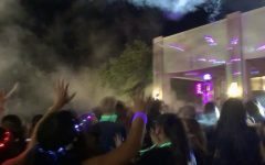 Members of the classes of '24 and '25 enjoy the glow-themed dance held in the Fr. Downey Garden.