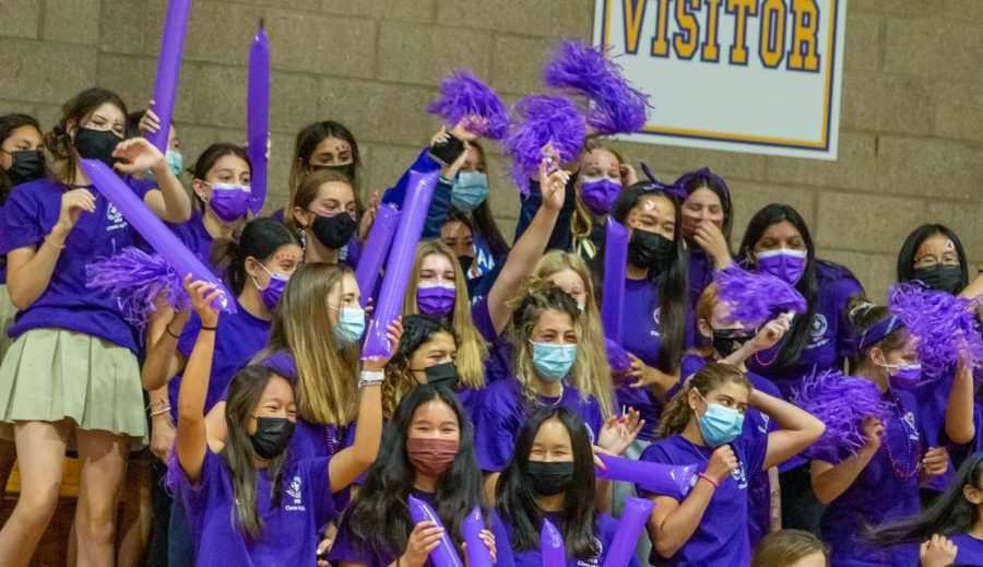 Freshmen decked out in their class color cheer for their new sisters at their first high school rally.