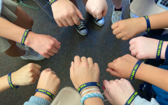 Students show their support with blue and gold awareness wristbands.